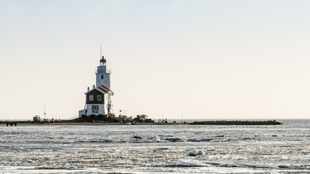 marken: A beautiful beach and lighthouse at sunrise (Marken The Netherlands)