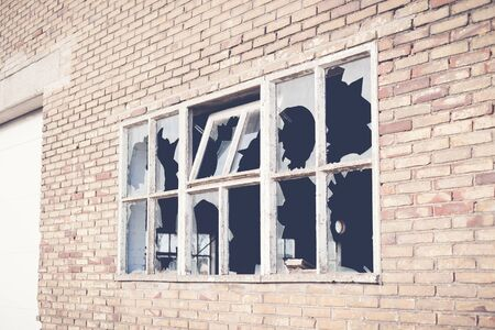 Broken glass at Window of old industrial urbex building photo
