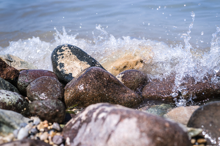 waves  pebble: Colorful Rocks with splashing waves. pebble stones by the sea on a beach