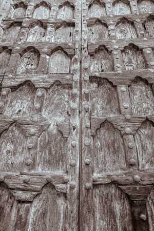 the old church: Ancient wooden door in old church, Italy Stock Photo