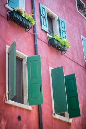 mediterranean house: Nice mediterranean house facades with shutters and  different colours Stock Photo