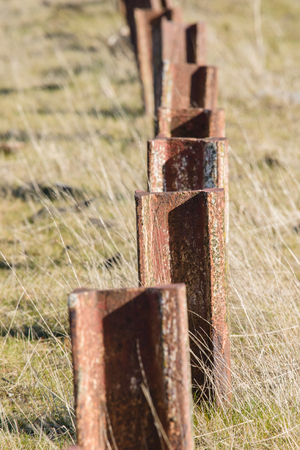 deposition: Old standing up rusted railway steel, to foreclosure or deposition Stock Photo