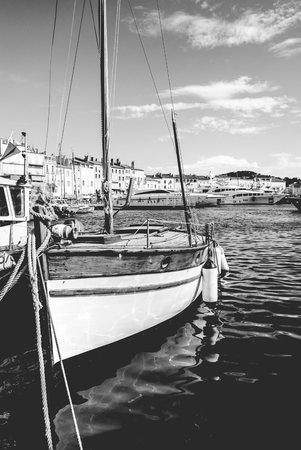 old ship: Old beautiful vintage wooden sail boat tall ship in the Port of Saint-Tropez, French Riviera
