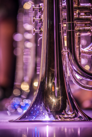 Close up and details of playing musicians, instruments in a marching, show band or music band