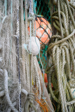 fishing gear: Closeup of old colorful mooring ropes , Old buoys and fishing gear at the island Texel. Netherlands