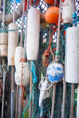 texel: Closeup of old colorful mooring ropes , Old buoys and fishing gear at the island Texel. Netherlands