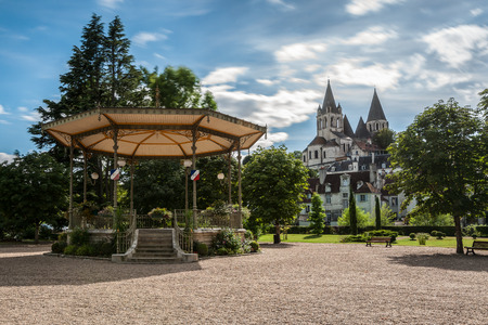 bandstand: Collegiate Church Saint-Ours Loches of Loches (France). Founded between 963 and 985. View from city park with bandstand