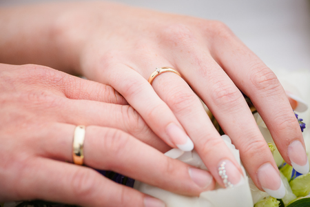weddingrings: A newly weding couple showing off their wedding rings. Stock Photo