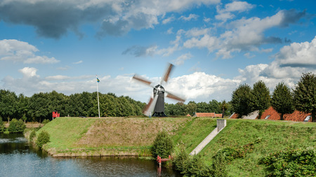vesting: Old windmill in the renovated historic fortress town of Bourtange in Groningen, the Netherlands.