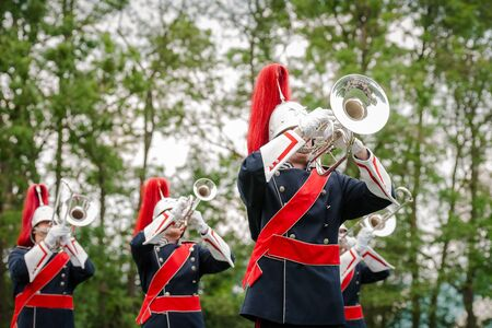 Military fanfare playing at trumpet and other wind instruments for occasion. Stock Photo
