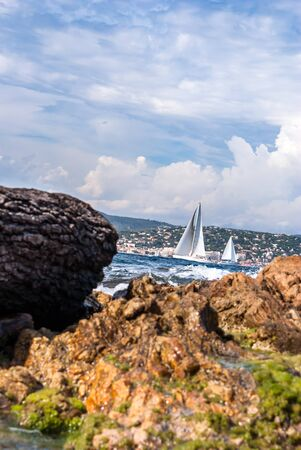 The mediterranean sea with boats along the coast near Saint Tropez