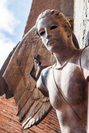 angeli: Bronze Angel On churchdoor in Rome, Italy Stock Photo