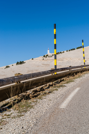 The road to the summit of Mont Ventoux seen from the village of Bedoin in Provence, Southern France Stock Photo