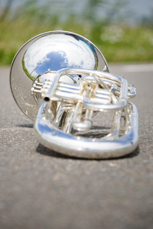 Close up of a detached silver marching baritone.