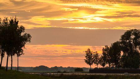 Sunset along old dyke in Netherlands near Kampen Stock Photo