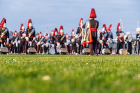 Details from a music, show and marching band. Defocused background with grass and evening sun to use as wallpaper Stock Photo