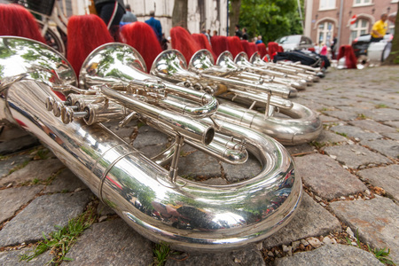 Details from a music, show and marching band. Composition of helmets and wind instruments, baritone on the street. Stock Photo