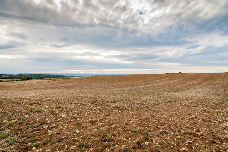 Plowed fields with glowing hills in the rhone valley of France Stock Photo