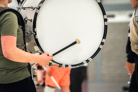 Musicians march, play and make music with large bass drums Stock Photo
