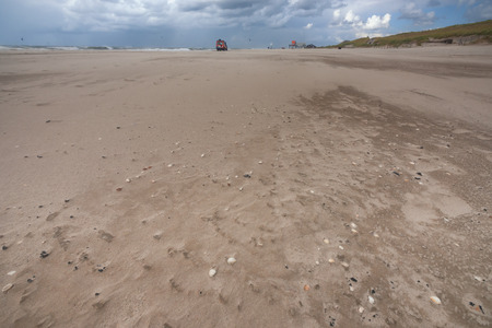 Details of threatening summer storm on the sandy beaches of the Dutch coast,
