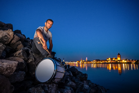 Various details of a performing music artist with percussion instruments Stock Photo