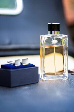 Beautiful square men perfume bottle. Beautiful luxury perfume bottle. Process of making perfumes.