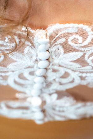 Bride in a wedding dress posing,Close-up open shoulders of a bride. Lace dress. Фото со стока