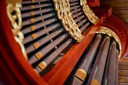 Details of a dutch church organ with housework, organ pipes and keyboard Foto de archivo - 129650099
