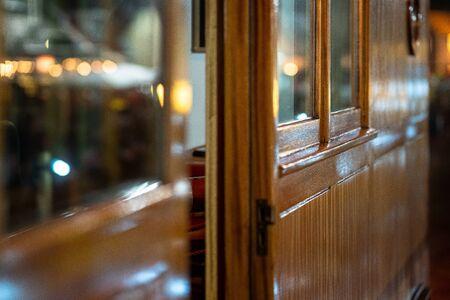 Wood paneling of the wheelhouse on a classic ship