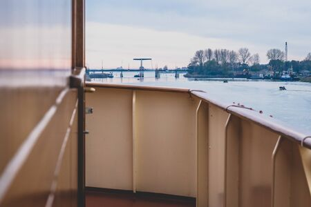 View from the wheelhouse of a boat over a van e channels and lakes in the Netherlands