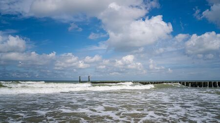 Beautiful view over the waves of the North sea coast, Zeeland, Netherland