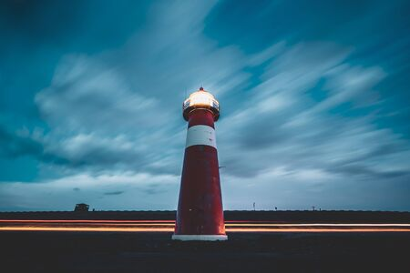 Small vintage lighthouse along the sea dike at Westkapelle in Zeeland, the Netherlands