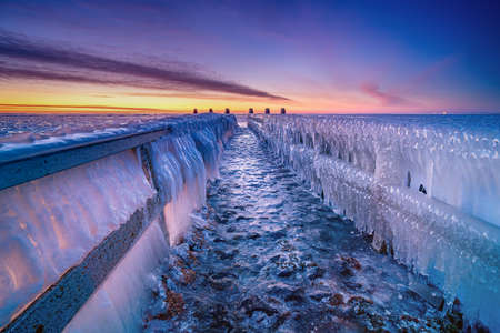 Frozen water as ice, created by wind and waves at the dutch shore throughout the winter