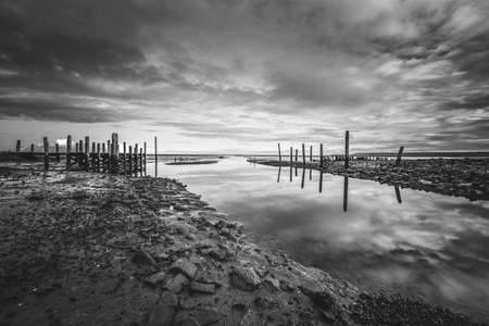 This old forgotten harbor is located near the village of Cocksdorp on Texel, in the middle of the  Wadden Sea area. 免版税图像