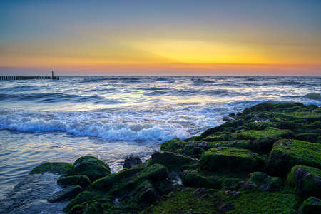 Beach in The Netherlands at the province Zeeland with windy sea weather and a long exposure image 免版税图像