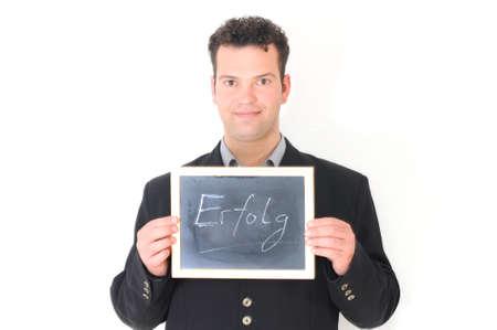 mann: Erfolg - Mann mit Tafel Stock Photo