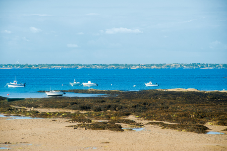 boats resting on water at lowtide in le petit vieil on the isle of Noirmoutier in summertime