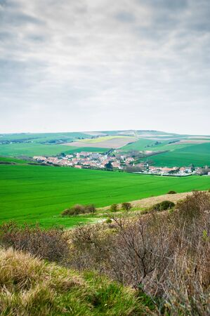 view on the landscape and the village l Escale when mounting the cliff of Cap Blanc Nez in springtime in the region of Nord Pas de Calais Фото со стока