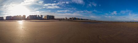 panorama of sand on the beach in a warm autumnal sunlight