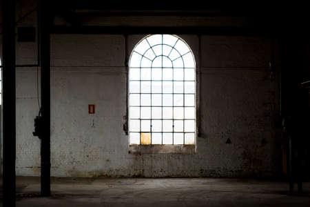 Window in an dark abandoned building
