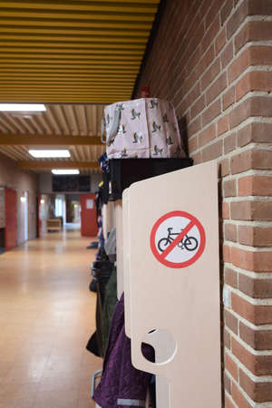 A no bicycle sign on students coat rack Stockfoto