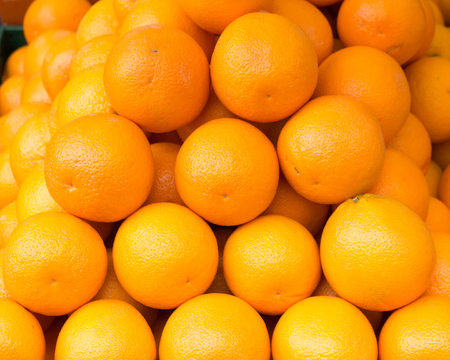 bunch of fresh juicy oranges on the market
