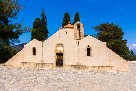 Front of old historic beige christian byzantine orthodox monastery church building