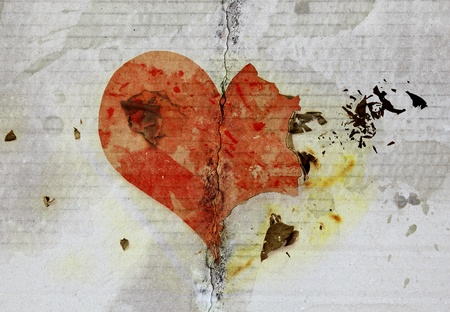 separate: burned and tear heart on paper background