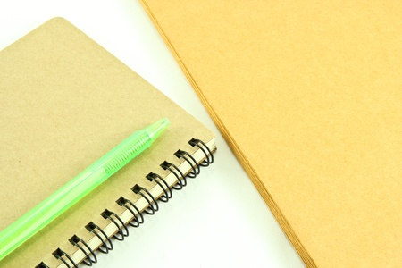 notebook and envelope on white background photo