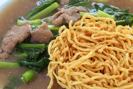 crispy yellow noodle with in a creamy gravy sauce photo