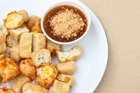 fritter: Fried tofu and corn fritter with sauce Stock Photo