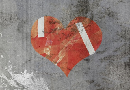damaged heart on old paper photo