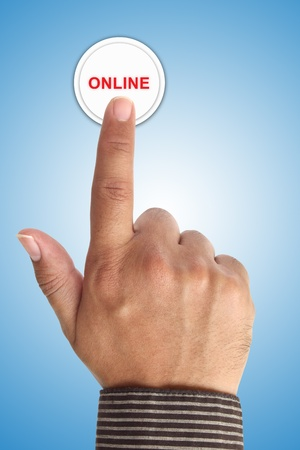 Hand Pushing Online Button photo