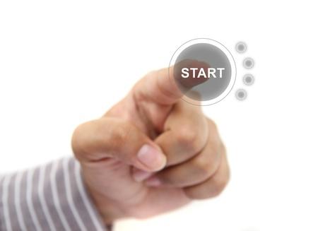 de hand te duwen startknop Stockfoto